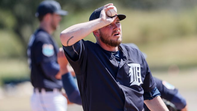 Detroit Tigers pitcher Alex Wilson takes a moment during spring training at Joker Marchant Stadium in Lakeland, Fla., on Feb. 19, 2016.