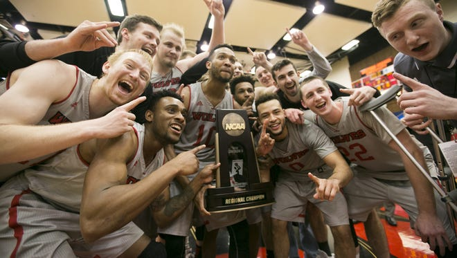 Western Oregon celebrates with the NCAA Regional Champions trophy after their 60-55 win against UC San Diego in the third round of the NCAA Division II Tournament on Monday, March 14, 2016, in Monmouth, Ore.
