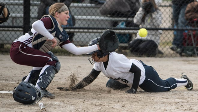 Gull Lakes' Lauren Esman slides into home plate during the Gull Lake Invitational on Saturday.