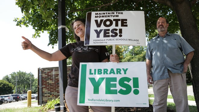 Ferndale Public Schools Board of Education member Karen Twomey stands outside of the Gerry Kulick Community Center in Ferndale on Tuesday August 2, 2016 encouraging voters to vote yes for the schools sinking fund.