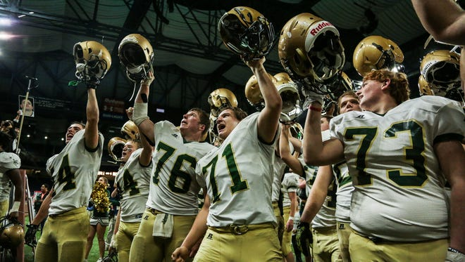 Jackson Lumen Christi players celebrate winning the division 6 high school football state championship game on Friday November 25, 2016, at Ford Field in Detroit, MI.