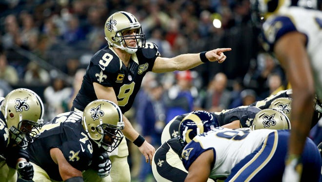 New Orleans Saints quarterback Drew Brees (9) points to the Los Angeles Rams' defense during the first half Nov. 27, 2016.