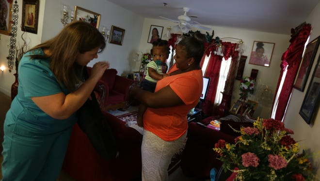 Nurse- Family Partnership nurse Jennifer Turner says good bye to Kaiden Cotton, 7-months-old, and his mother Brittany Addison, 22, after a home visit in Darlington, South Carolina in June 2016.