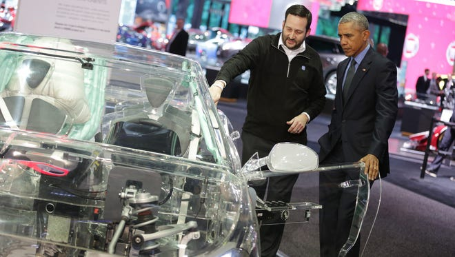 Bryan Johnson, Senior Manager, Corporate Communications for ZF North America, is explaining to President Barack Obama at the ZF display how autonomous driving technology works at the 2016 North American International Auto Show at Cobo Center downtown Detroit in January 2016.