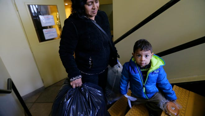 Olga Chacon of Freehold Boro and her 2-year-old son Jason Mijangos leave the Project Homeless Connect and Point In Time Annual Count with new clothing and snacks at New Beginnings Agape Christian Center in Freehold, NJ Wednesday, January 25, 2017.
