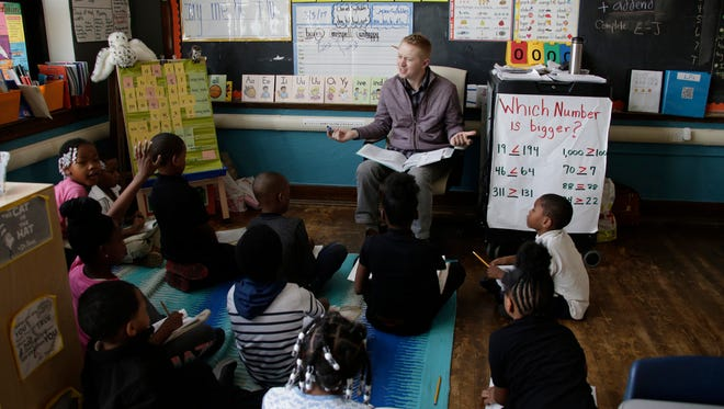 Second grade teacher Sean Deiters works with his students at Nolan Elementary and Middle School in Detroit Friday Mar. 3, 2017. As the state moves to eliminate the Education Achievment Authority and return schools, like Nolan, to the Detroit Public Schools.