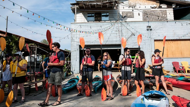 Kayak to Table attendees line up to board their kayaks at Detroit River Sports, Sunday, July 9, 2017 in Detroit.