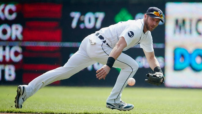 Andrew Romine attempts to make a play on a ball in the first inning of the Tigers' 3-2 loss to the Athletics on Wednesday, Sept. 20, 2017 at Comerica Park.
