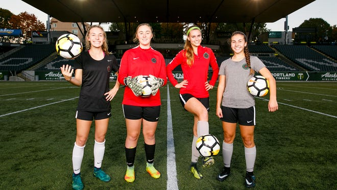 (Left to right) Silverton's Paige Alexander, and West Salem's Abbey Knoll, Karly Feis-White and Lexi Tejeda at a Thorns Academy soccer practice on Tuesday, Oct. 24, 2017, at Providence Park in Portland, Ore. The four high school students play for the Portland Thorns Under-17 team, an elite soccer program for players under the age of 17.
