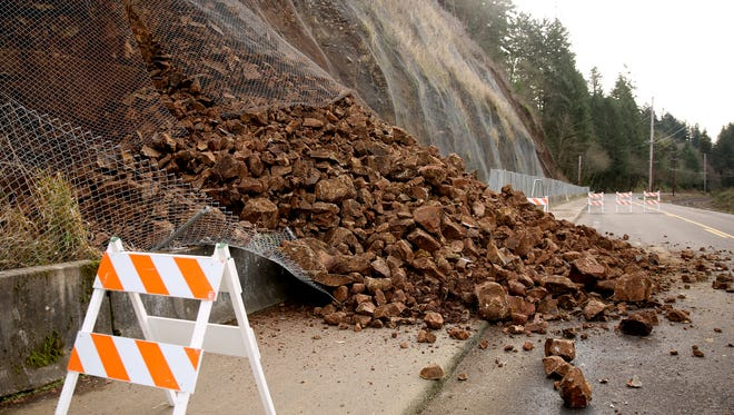River Road South is closed between Owens Street S and Minto Island Road after a rock slide. Photographed in Salem on Tuesday, Jan. 2, 2018.