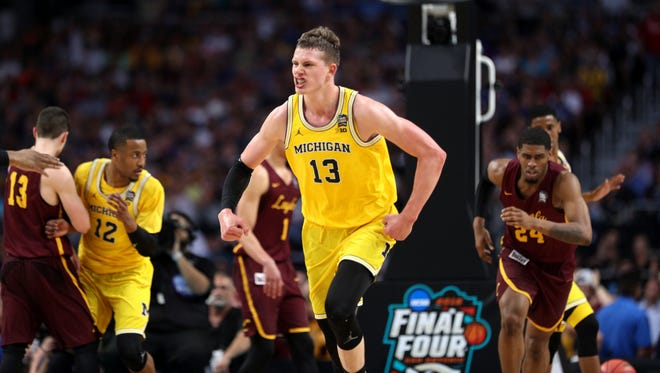 Michigan's Moritz Wagner celebrates a shot during the second half against Loyola-Chicago on Saturday at the Alamodome in San Antonio.