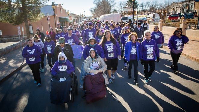 "Members of ""Team Lita"" walk during Cancer Aid Resource & Education's Race for Care event in Mesilla. Sonja Portillo, who organized the team on behalf of her sister Lita Luan, who is battling pancreatic cancer, says up to 69 people participated in the team to raise money for CARE."
