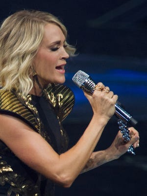 """Carrie Underwood performs at Bridgestone Arena in September. The singer performed her hit song """"Something in the Water"""" on Monday during the Passion 2017 conference at the Georgia Dome in Atlanta."""