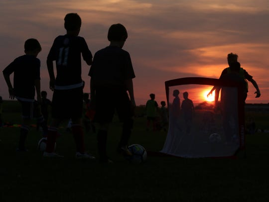 Members of the GPS Delaware Revolution soccer teams practice on the Delaware Sports Complex fields along Levels Road in Middletown.