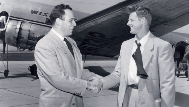 Jack Vainisi (left), Green Bay's personnel director, meets rookie wide receiver Billy Howton at the airport in Green Bay in 1952.