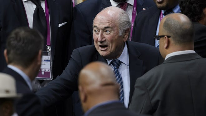 FIFA president Sepp Blatter (C) reacts surrounded by delegates after being re-elected during the FIFA Congress in Zurich on Friday.