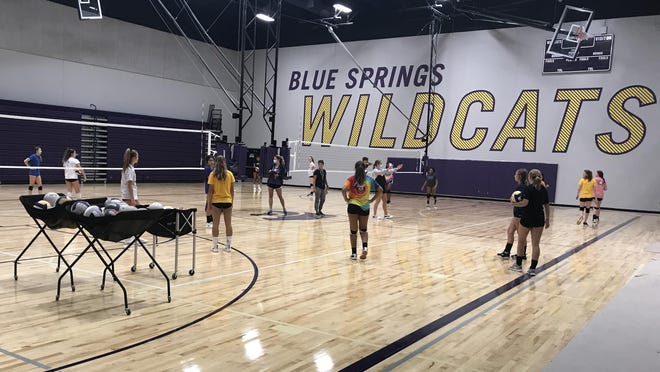 Members of the Blue Springs volleyball team practice in the school's new auxiliary gymnasium, which is located on the west side of the high school. A new band room for the Golden Regiment and other Wildcat bands is also part of the project.