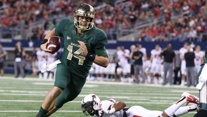 Baylor Bears quarterback Bryce Petty (14) runs in for a quarter touchdown against the Texas Tech Red Raiders at AT&T Stadium.
