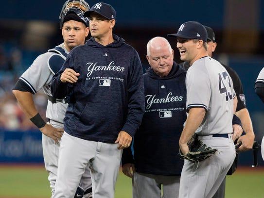 New York Yankees pitcher Adam Warren grimaces on the