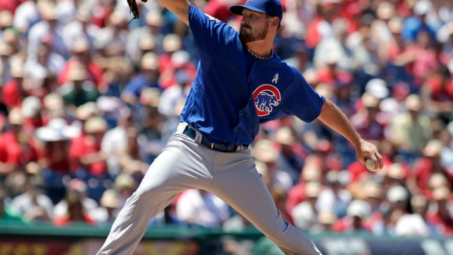 Chicago Cubs starting pitcher Travis Wood throws against the Philadelphia Phillies in the first inning on Sunday.