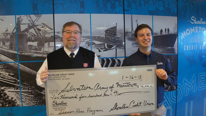 Shoreline Credit Union CEO Nathan Grossenbach presents a check to Lt. Jeff Olsen, commanding officer of the Salvation Army of Manitowoc.