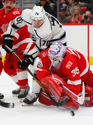 Red Wings goalie Jimmy Howard (35) stops a Kings left wing Tanner Pearson (70) shot in the first period on Tuesday, Nov. 28, 2017, at Little Caesars Arena.