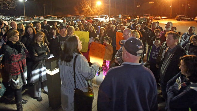 Deborah L. Munitz, enter, talks to the protesters gathered outside of Ramapo town on March 8, 2016, after the schedule meeting was postponed to March 16th. Ramapo residents were protesting a possible four-story dorm for Spook Rock Road.