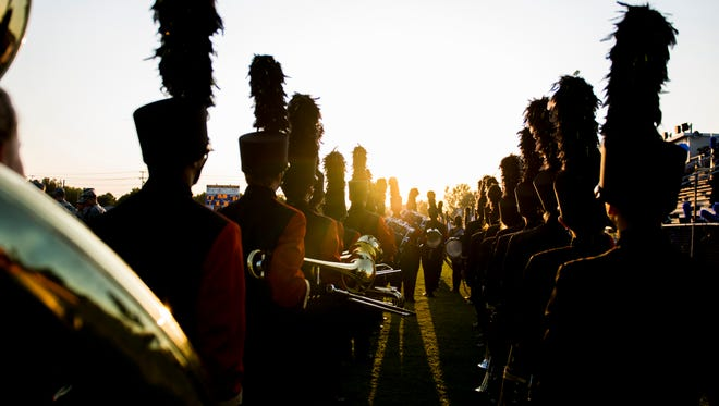 Rossview's band stands at attention before approaching the field for their pregame show on September 8, 2017.