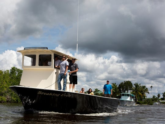 In this file photo, stone crab fisherman approach the dock at the Rod and Gun Club in Everglades City for the annual Blessing of the Stone Crab Fleet on Sept. 26, 2015.