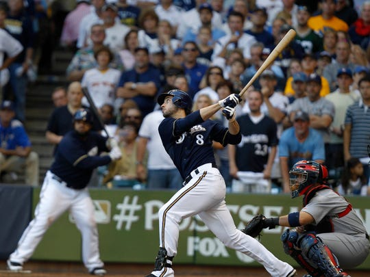 The Brewers' Ryan Braun hits a double against the Cardinals during the first game of the NLCS n 2011.