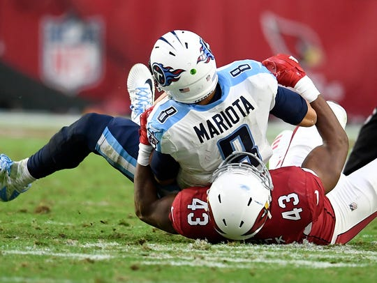 Titans quarterback Marcus Mariota (8) is sacked during