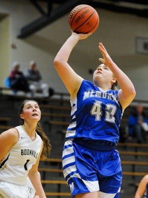 Memorial's Olivia Phipps (42) shoots past Boonville's Arielle Blankenship (1)  during their game at Boonville High School, Friday, Nov. 18, 2016.