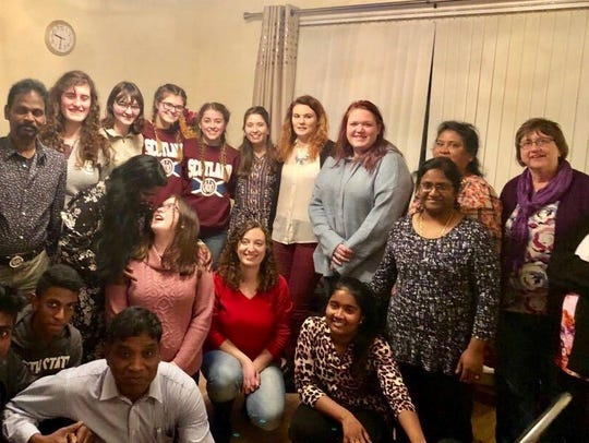 Donna Trower, far right, was visiting the home of a church member March 13 in Glasgow, Scotland. This photo of church members and Evangel University students was snapped about 30 minutes before Trower fell ill.