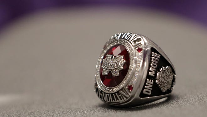 """Mississippi State head coach Vic Schaefer ring is displayed in the locker room during the women's NCAA Final Four college basketball tournament, Saturday, March 31, 2018, in Columbus, Ohio. After falling short of the school's first national championship last season, the team has a constant reminder of that on their runner-up rings where the phrase """"one more"""" is engraved on the side of it. Mississippi State will play Notre Dame on Sunday. (AP Photo/Tony Dejak)"""