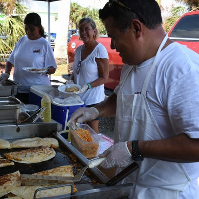 Neighbor helping neighbor: Capri residents come together for a hot meal and cold beer