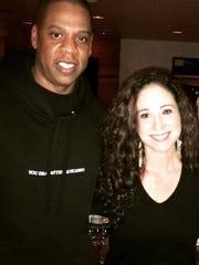 Georgetown's Danielle Furst with hip hop artist Jay Z.