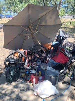 Redding police gathered items from illegal campsites Saturday.