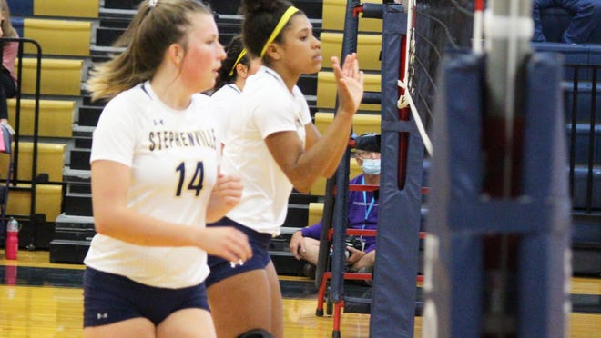 Two of Stephenville's middle blockers, Jaydi Griffin (left) and Alee McClendon, have made successful recoveries from knee surgery to help the Honeybees gain a No. 5 state ranking.