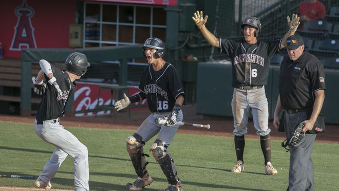 Hamilton's Hayden Baker (9) Britt Graham (16) and Jacob Thiele (6) celebrate Baker scoring and Hamilton taking a 5-3 lead in the sixth inning against Horizon at Tempe Diablo field in Tempe, Ariz. on May 12, 2017.