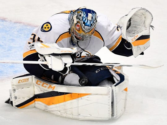 Nashville Predators goalie Pekka Rinne (35) makes a save in the third period of game two in the first-round NHL playoff series at the United Center, Saturday, April 15, 2017, in Chicago, Ill.