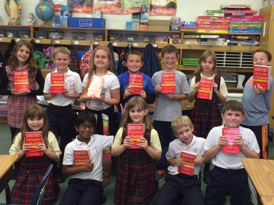 Third grade students at the Epiphany School in Sayre received dictionaries from the Rotary Club of Sayre.