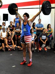 Jess Andrews completes a successful squat-snatch during day two of competition at the Inaugural 2016 Latte Games held from Jan. 16-17 at the CrossFit Latte Stone Gym in Harmon.