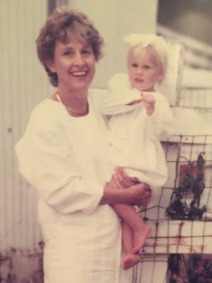 Jan Oliphant's smile as she held her granddaughter Torrie Tinley belied her longstanding back pain.