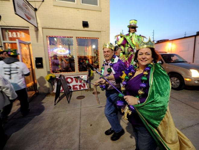 Wendell Walters, street commissioner, and Barbara Lawrence, town manager, were the king and queen of the Mardi Gras on Main Pub Crawl, Friday, February 28, 2014, in Speedway.