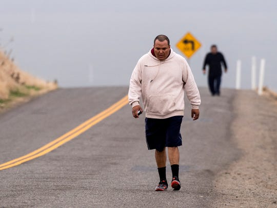Saul Valenzuela, near, and Manuel Talamantez climb Rocky Hill Drive in Exeter on Wednesday, January 3, 2017. Poor air quality in Tulare County continues to be an issue for those working or exercising outdoors.