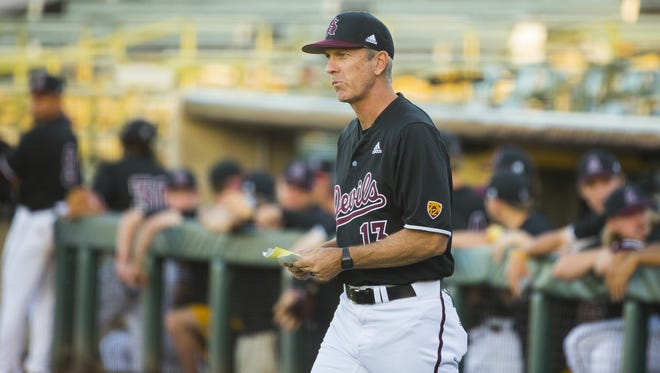 ASU's head coach Tracy Smith (13) walks out to the umpires before the start of a game against California at Phoenix Municipal Stadium in Tempe, Ariz. on May 24, 2018.