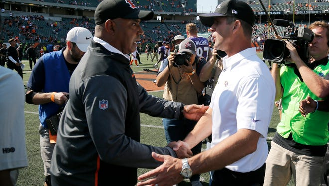 Cincinnati Bengals head coach Marvin Lewis shakes hands with Baltimore Ravens head coach John Harbaugh after the fourth quarter of the NFL Week 1 game between the Cincinnati Bengals and the Baltimore Ravens at Paul Brown Stadium in downtown Cincinnati on Sunday, Sept. 10, 2017. The Bengals were blown out, 20-0, in there season opener.