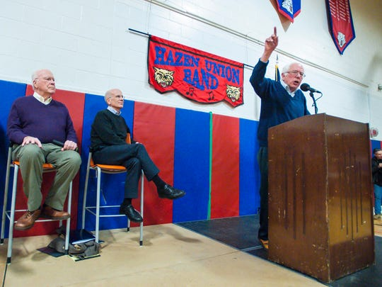 U.S. Senator Bernie Sanders, right, speaks during a town hall meeting held by Vermont's congressional delegation at Hazen Union High School in Hardwick on Saturday, March 25, 2017. Looking on are U. S. Senator Patrick Leahy, left, and U.S. Rep. Peter Welch.