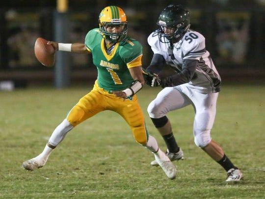 Coachella Valley quarterback Armando Deniz is sacked