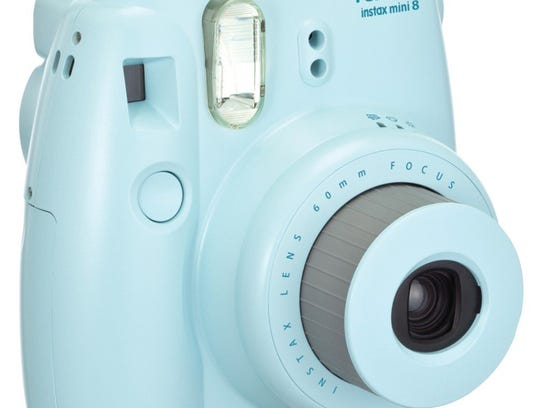This is a Fujifilm Instax Mini 8. Fujifilm and Polaroid, iconic names in the world of photography, both lost their luster as Americans turned to smartphones and apps to record their memories.